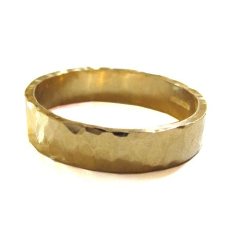 hammered 18k gold wedding ring by catherine marche