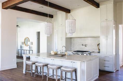 white kitchen cabinets  light gray wash