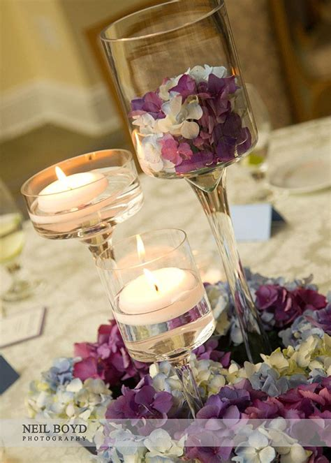 floating candle centerpieces blue purple hydrangea