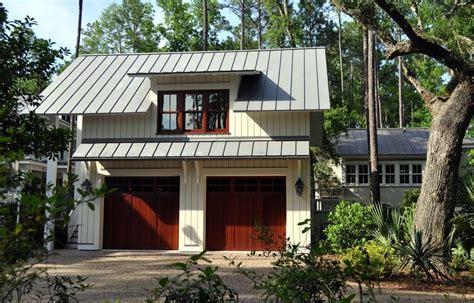 metal garage  apartment  traditional garage  dormer windows garage garage door gravel