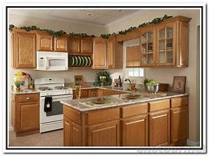White kitchen cabinets with white appliances oak kitchen for Kitchen cabinet trends 2018 combined with white lantern candle holder