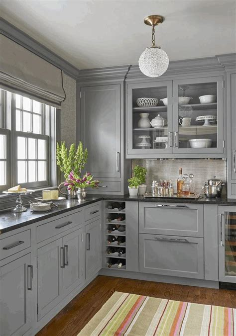 Kitchen Floor Tile Pattern Ideas - white cabinets grey countertops round white and gold hanging l light grey wall painting