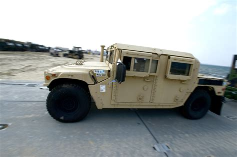 A U.s. Soldier Drives An Up-armored Humvee Down A