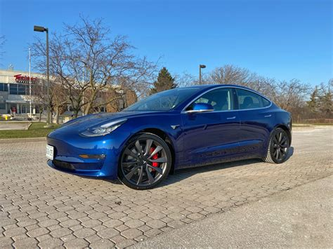 18+ Tesla 3 Performance Grey Background
