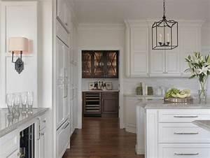 Painted White Kitchen With Walnut Wet Bar