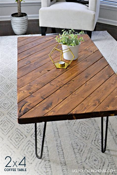 Designing and fabricating a wooden coffee and game table using old, reclaimed wood will create an instant conversation piece in your living room. Remodelaholic | 20 Easy DIY 2x4 Wood Projects