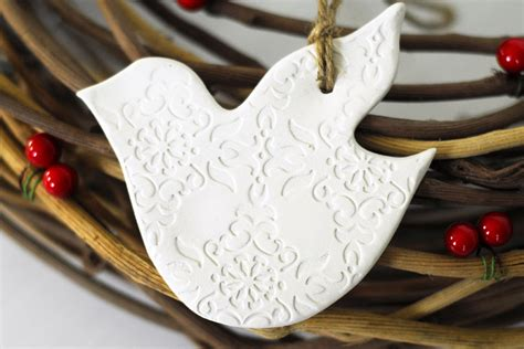 pair of ceramic white dove christmas ornaments felt
