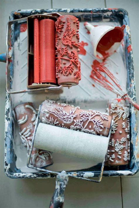 patterned paint rollers create classic wallpaper