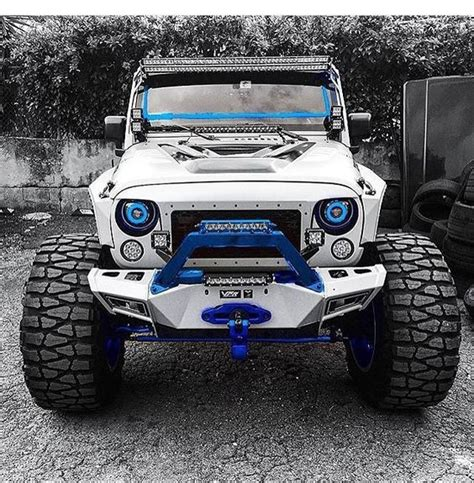 jeep mud white jeep jk with blue trim and nitto mud grappler tires