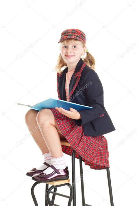 Teen Girl In School Uniform Reading A Book Stock Photo Denoiser