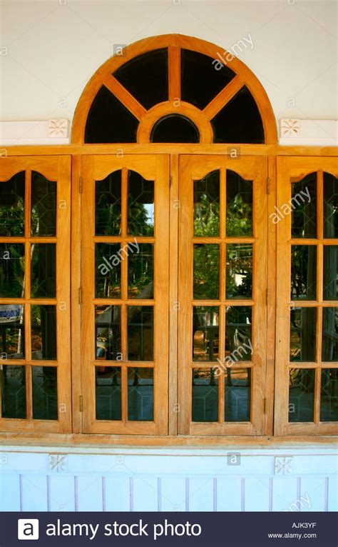 glass windows   modern house kerala stock photo