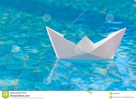Origami Boat In Water by White Paper Boat Floating In The Water Stock Photo Image