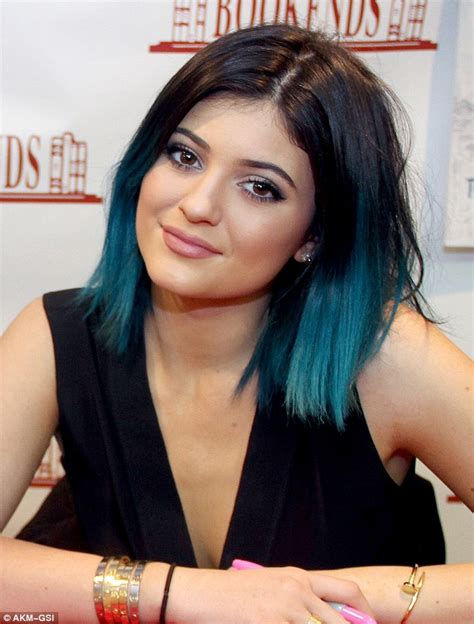 kylie jenner shows  blue hair    cut jumpsuit