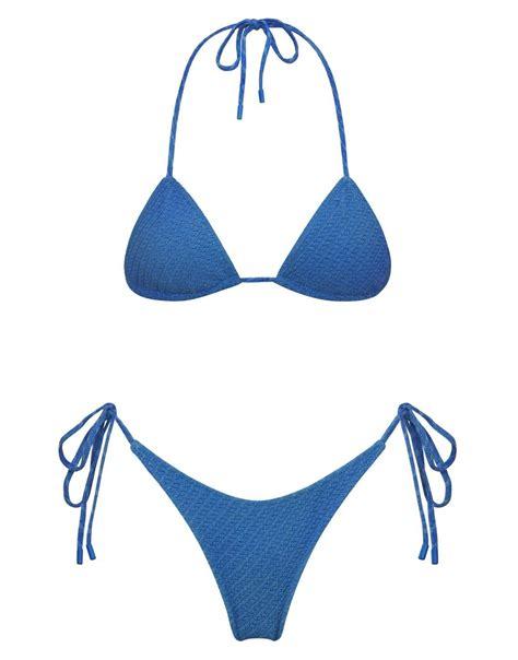 A textured pattern side-tie bikini in bright blue. Fully ...