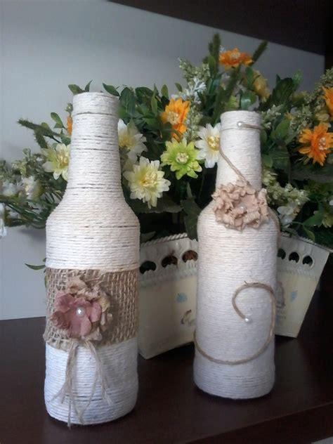 par de garrafas decoradas  barbante  elo marmel