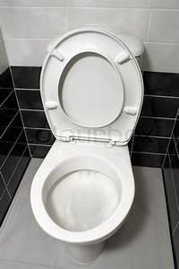 White toilet bowl with open toilet seat ... | Stock image ...