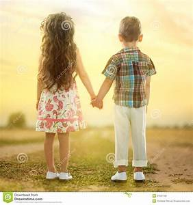 Back View Of Little Kids Holding Hands At Sunset Stock ...