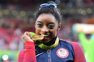 Simone Biles takes gold with dominant Olympic performance ...