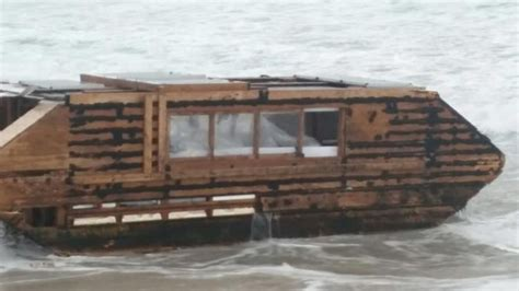 Houseboat Ocean by Mysterious Houseboat Washes Up On Irish Shore After