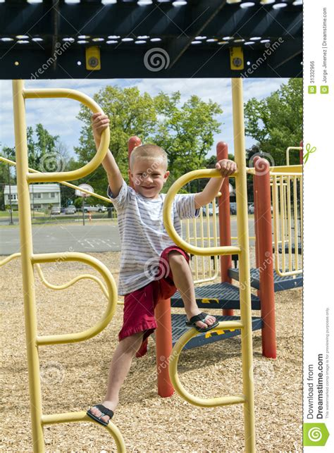 boy climbing up jungle on playscape royalty free stock 270 | boy climbing up jungle gym playscape young climbs yellow preschool playground 31332966