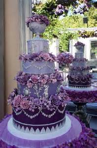 planning a wedding fancy purple wedding cake with purple flowers arabia