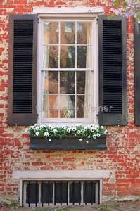 Brick House with Window Flower Boxes