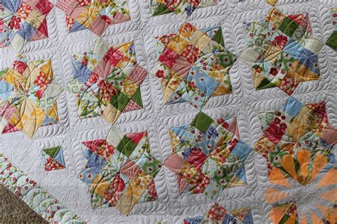 quilting at the n quilt custom machine quilting a scrappy quilt by