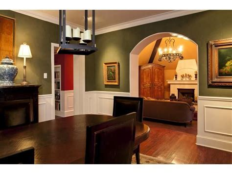 green dining room also interesting that the archway is painted to match molding and trim