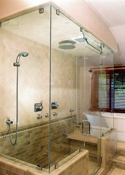 handheld shower head attached    glass wall