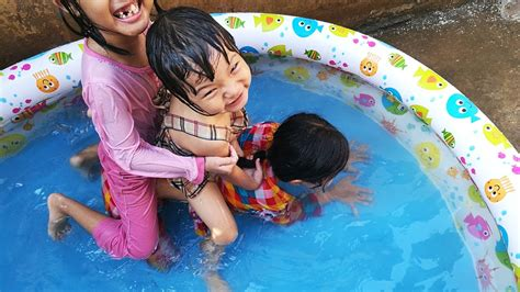 Kids Swimming In Plastic Swimming Pool