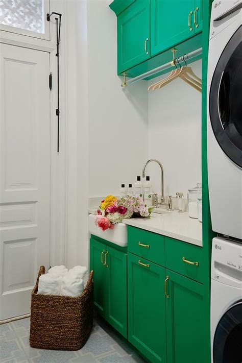 emerald green laundry room cabinets  gold pulls