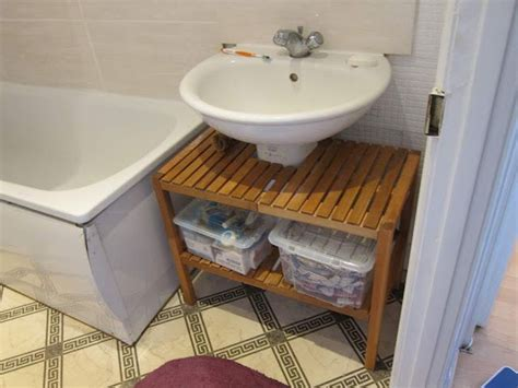 This Is A Brilliant Way To Cover Up An Ugly Pedestal Sink