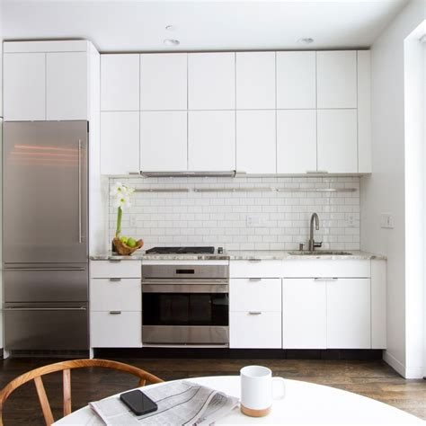 white kitchen subway tile backsplash white kitchen cabinets the backdrop for a chic decor 1828