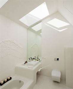 A White Bathroom With A Lot Of Daylight Thanks To The