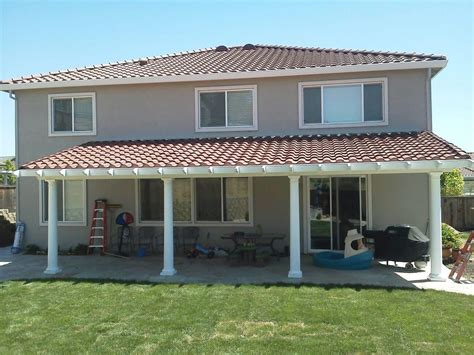 an insulated patio cover with tile roofing to match the