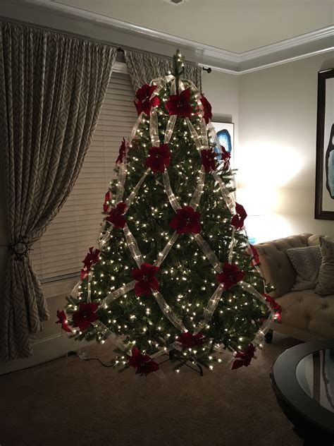 christmas tree without lights without ornaments and tree topper just ribbon lights and