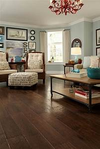 Love the ottoman and dark wood floor wall color