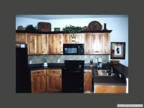 pictures of kitchen backsplash exle of hickory with black black counter top and grey backsplash home kitchen