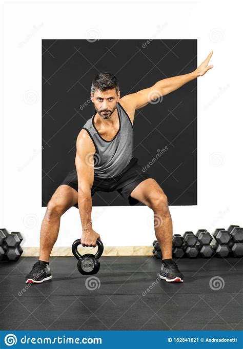 weight exercises kettlebell doing lifting body