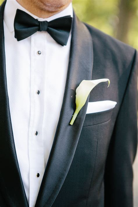 black tuxedo  white calla lily boutonniere