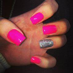 Neon pink nails with a sparkle French tip look