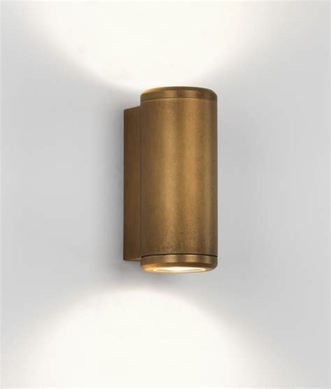 up and down wall lights up down coastal wall light in antique brass finish