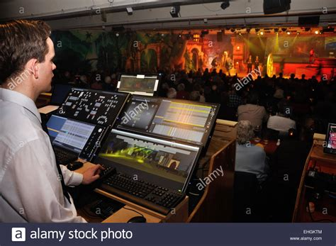 Lighting Technician by A Lighting Technician Controls Special Effects For A Live