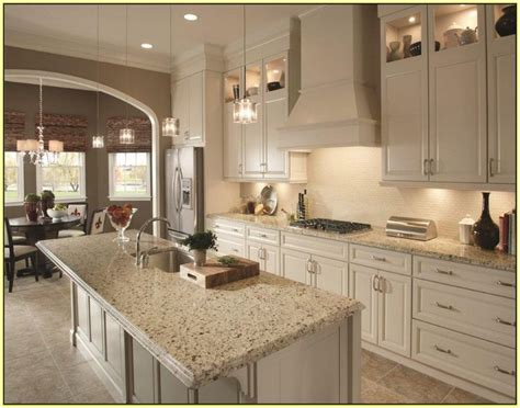 crema perla granite  cream cabinets  backsplash