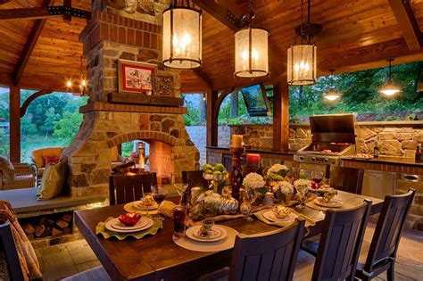 lavish covered patio featuring dining set up grill and