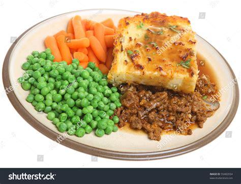cottage pie gravy shepherds pie with peas carrots and gravy stock photo