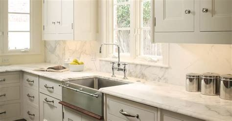 kitchen with backsplash white cabinets marble counter tops and stainless 6549