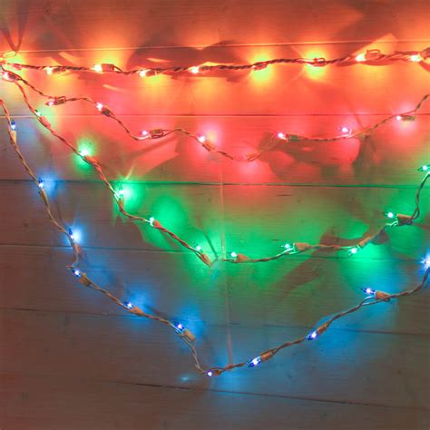 multicolored bulb and white cord swag style string lights