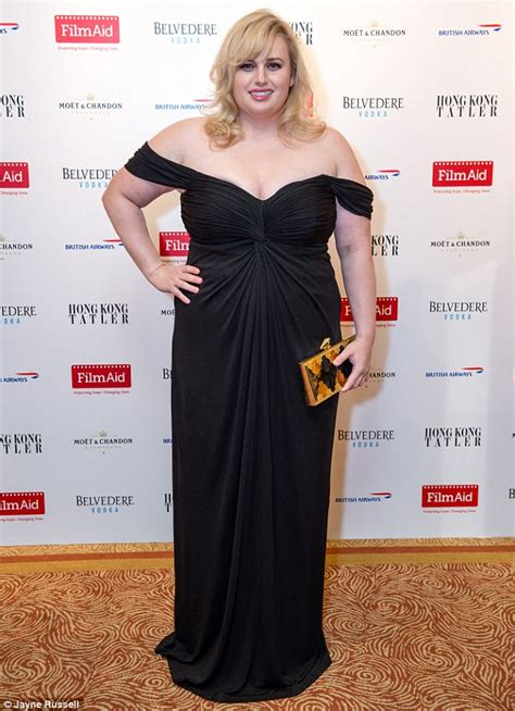 Rebel Wilson dazzles in black dress at Hong Kong charity ...
