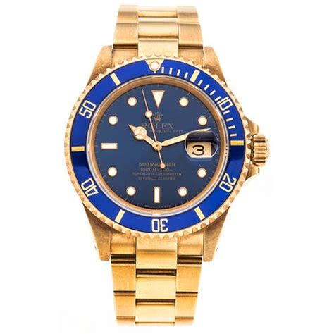 ROLEX OYSTER PERPETUAL DATE SUBMARINER. 18K YELLOW GOLD ...